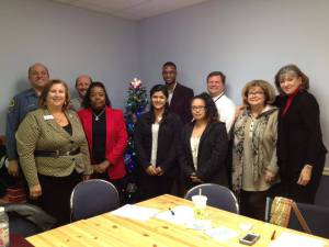 Josselyn (front center) with the GUIDE Board of Directors in December 2013.