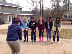 Josselyn (third from the left) practicing an energizer at Staff Development Weekend 1 for Georgia Teen Institute.