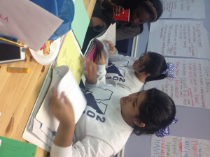 Josselyn (far right) working hard at a YAB meeting!