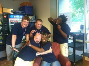 John Lee (bottom left) being silly with fellow staff at GTI.