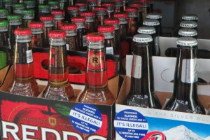 Warning stickers on multi-packs of beer at Way Crest Exxon in Grayson, GA.