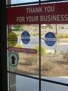 Warning glass clings on the front doors at Beverage Superstore in Grayson, GA.