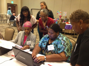 Sylvia Comer of Elite Women of Excellence participates in researching a relevant topic during the GOCF-funded Project Based Learning workshop in 2013.